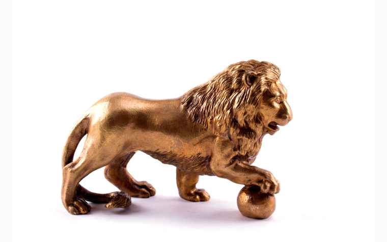 Bronze statuette Lion with paw on the ball  (right)