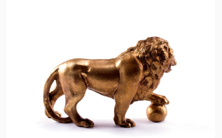 Bronze statuette Lion with paw on the ball (left)